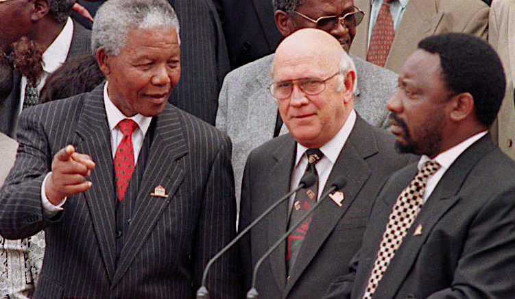 Mandela, FW de Klerk and Ramaphosa outside Parliament on the day the new constitution was adopted, 8 May 1996